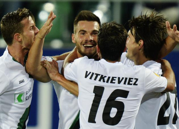FC St. Gallen's Goran Karanovic, center, celebrates with teammates after scoring the opening goal during the UEFA Europa League Group A soccer match between Switzerland's FC St. Gallen and Russia's Ku