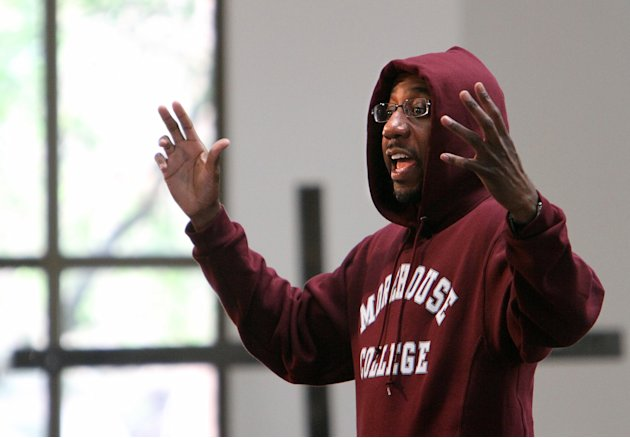 Rev. Raphael Warnock wears a hoodie during his morning sermon at the Ebenezer Baptist Church on Sunday, March 25, 2012, in Atlanta. Church-goers were invited to wear hoodies to services to show their
