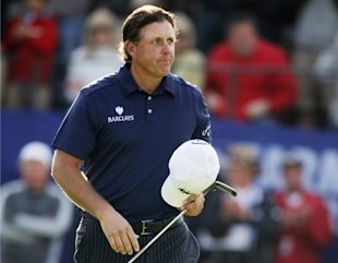 Mickelson walks off the 18th green after finishing second during Farmers Insurance Open PGA golf tournament in San Diego