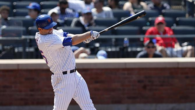 New York Mets' Dillon Gee hits a fifth-inning single in a baseball game against the Washington Nationals in New York, Sunday, May 3, 2015. (AP Photo/Kathy Willens)
