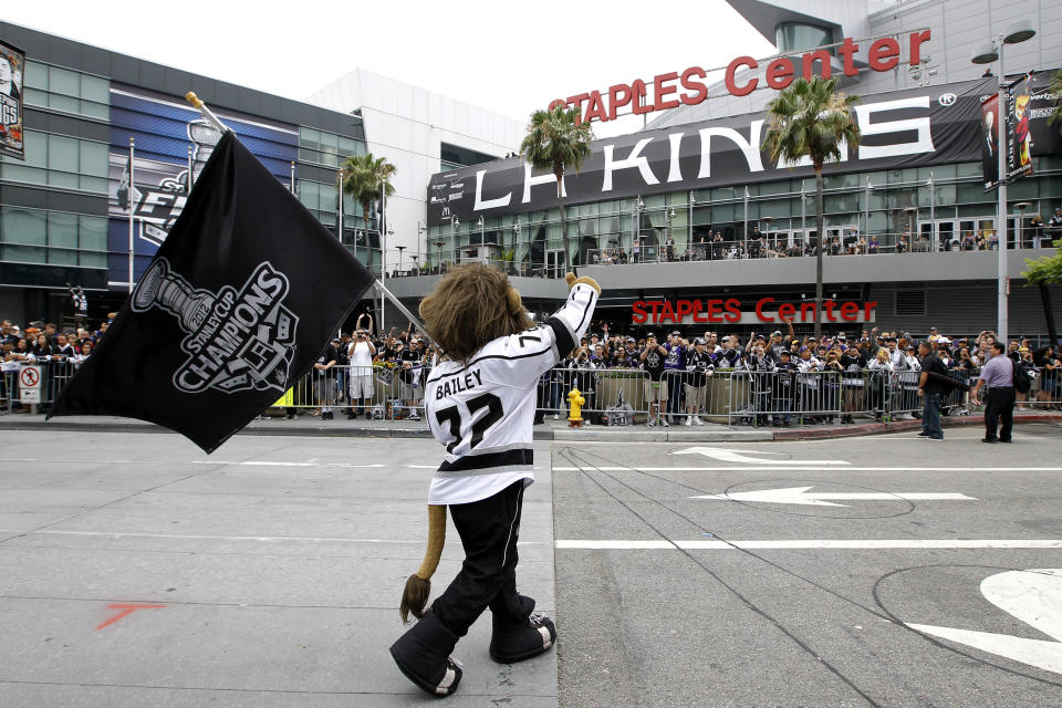 Los Angeles Kings mascot Bailey acknowledges the fans outside Staples Center before a parade celebrating the team's Stanley Cup win in Los Angeles, Thursday, June 14, 2012. (AP Photo/Jae C. Hong)
