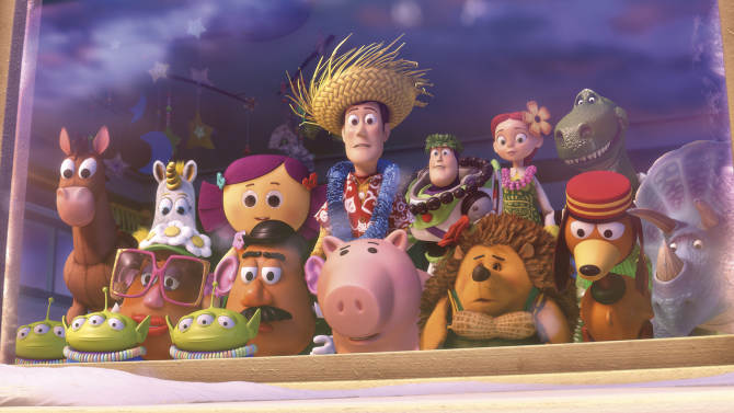 """In this film publicity image released by Disney-Pixar, a scene is shown from """"Toy Story: Hawaiian Vacation.""""  Woody the cowboy, Buzz Lightyear and their """"Toy Story"""" pals are back on the big-screen in a new adventure. The voices of Tom Hanks, Tim Allen, Michael Keaton, Joan Cusack are featured in a """"Toy Story"""" short film that runs before the Pixar Animation sequel """"Cars 2,"""" which debuts in U.S. theaters Friday. (AP Photo/Disney/Pixar)"""