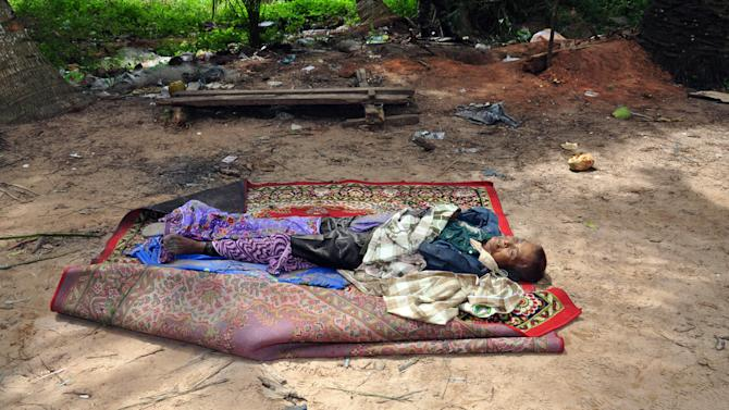 In this March 6, 2013 photo released by Malaysia's Ministry of Defense, a dead body of a Filipino gunman lies on the ground near the area where a stand-off with Filipino gunmen took place, at Tanduo village in Lahad Datu, Borneo's Sabah state, Malaysia. Malaysian security forces on Wednesday battled a group of Filipino intruders in the rugged terrain of Borneo after they escaped a military assault with fighter jets and mortar fire on their hideout, police said. One Filipino was shot and believed killed. (AP Photo/Malaysia's Ministry of Defense) EDITORIAL USE ONLY, NO SALES