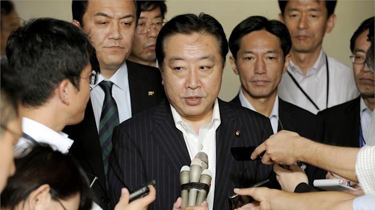 Finance minister yoshihiko noda speaks to reporters at the ministry