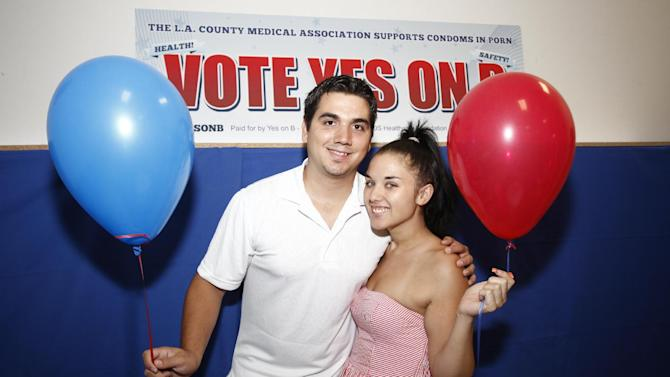 Former adult film performer Derrick Burts and his girlfriend Brianna Richardson seen at the AIDS Healthcare Foundation Election Headquarters victory party on Tuesday, November 6, 2012 in Los Angeles, California. (Joe Kohen /AP Images for AIDS Healthcare Foundation) Early results show strong support for Measure B