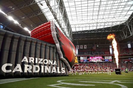File photo of Arizona Cardinals players enter the field prior to their NFL game against the Houston Texans in Glendale Arizona