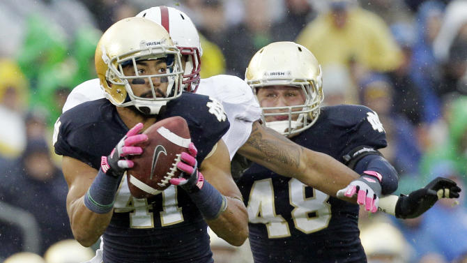 Notre Dame safety Matthias Farley (41) intercepts a pass past Stanford tight end Levine Toliolo (11) during the first half of an NCAA college football game in South Bend, Ind., Saturday, Oct. 13, 2012. (AP Photo/Nam Y. Huh)