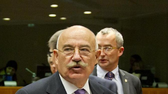 Hungary's Foreign Minister Janos Martonyi, center, arrives for a meeting of EU foreign ministers at the EU Council building in Brussels on Monday, Dec. 10, 2012. The 27 EU foreign ministers will discuss the situation in Syria, where activists say more than 40,000 people have died. (AP Photo/Virginia Mayo)