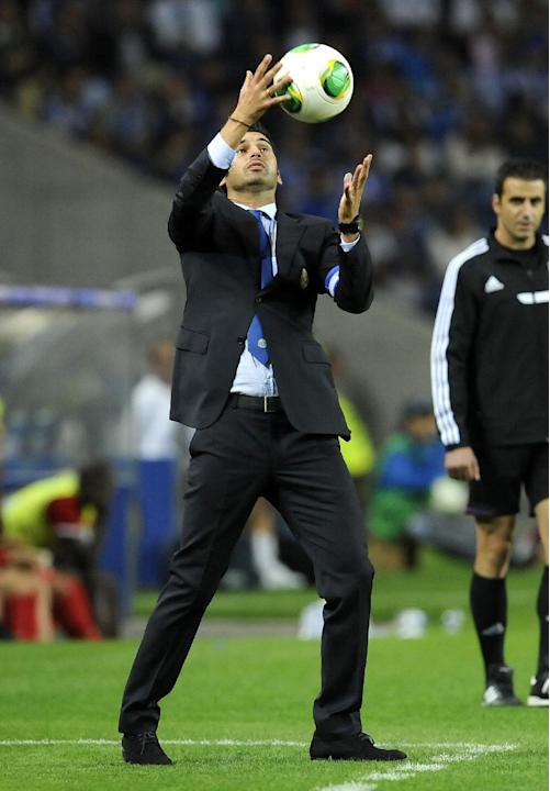 FC Porto's coach Paulo Fonseca catches a ball during a Portuguese League soccer match against Gil Vicente at the Dragao stadium in Porto, Portugal, Sunday, Sept. 14, 2013. Porto won 2-0