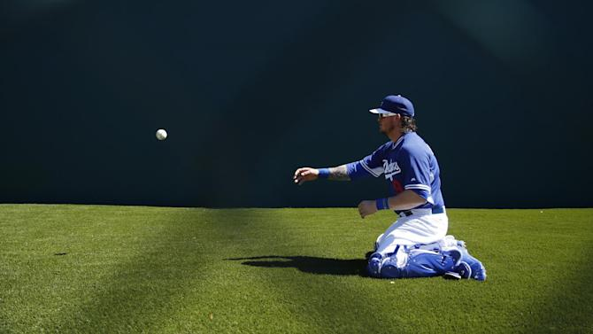 Los Angeles Dodgers' Yasmani Grandal warms up before a spring training exhibition baseball game against the Chicago White Sox, Wednesday, March 4, 2015, in Phoenix. (AP Photo/John Locher)