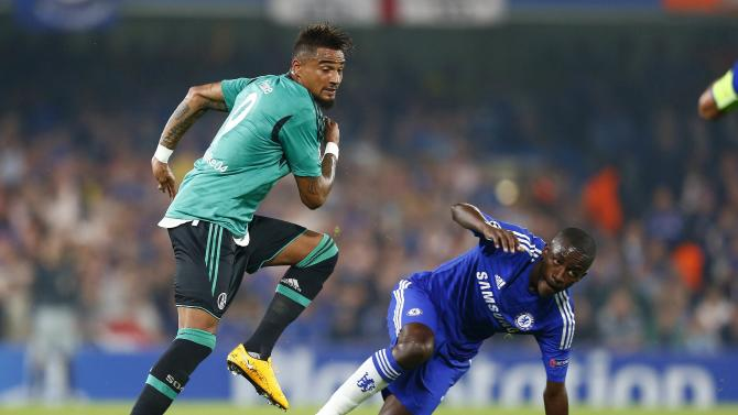 Chelsea's Ramires challenges Schalke 04's Boateng during their Champions League soccer match at Stamford Bridge in London