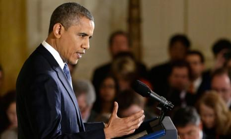 President Barack Obama answers questions at a news conference in the East Room of the White House on Nov. 14.