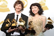 Gotye and Kimbra pose in the press room with their trophies at the Staples Center during the 55th Grammy Awards in Los Angeles, California, on February 10, 2013