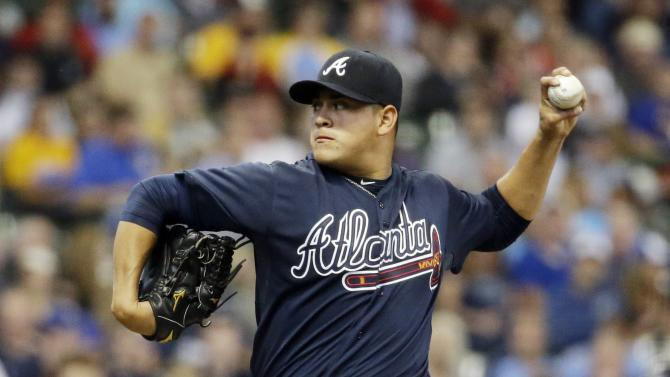 Atlanta Braves starting pitcher Manny Banuelos throws during the first inning of a baseball game against the Milwaukee Brewers Tuesday, July 7, 2015, in Milwaukee. (AP Photo/Morry Gash)