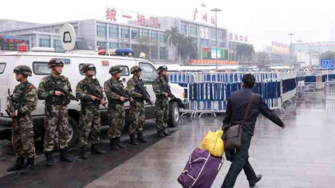 Police control the site after a knife attack outside the Guangzhou Railway Station