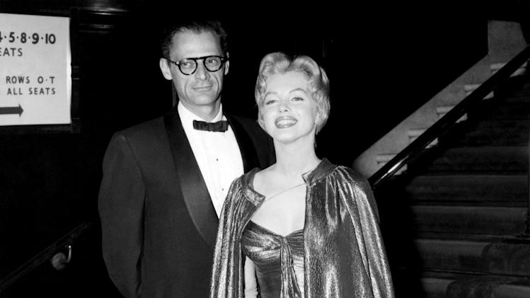 "In this late October 1956 publicity photo provided by Running Press, Marilyn Monroe, right, with husband Arthur Miller, is shown in the final weeks of filming ""The Prince and the Showgirl."" This goddess-like ensemble is in a burnished gold lamé. (AP Photo/Courtesy Running Press)"
