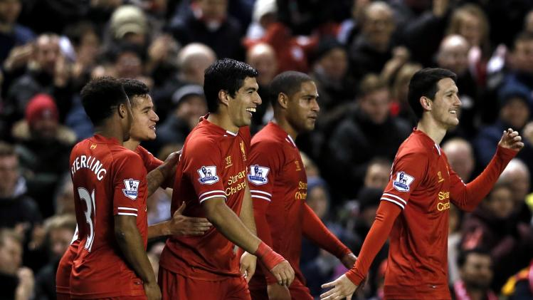 Liverpool's Suarez celebrates with team mates after scoring a goal against Norwich City during English Premier League soccer match in Liverpool