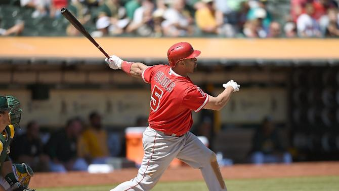 Albert Pujols of the Los Angeles Angels hits a two-run homer against the Oakland Athletics in at O.co Coliseum on September 2, 2015 in Oakland, California