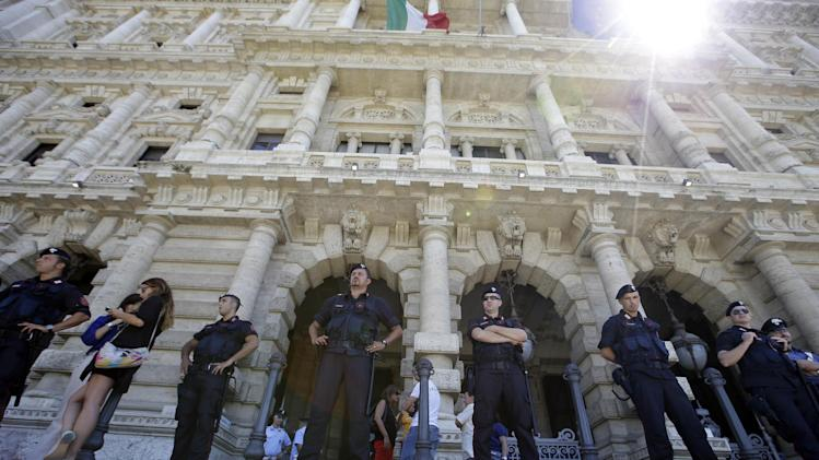 Italian Carabinieri, paramilitary policemen stand outside the Court of Cassation building where former premier Silvio Berlusconi's case on tax fraud will be decided, in Rome, Tuesday, July 30, 2013. Berlusconi's political fate is in the hands of Italy's highest court, which is preparing to hear arguments in the former premier's fraud conviction. Berlusconi has been convicted of tax fraud in a complex TV rights transaction for his Mediaset network, and sentenced to four-years in prison with a five-year ban on public office. This is his final appeal. (AP Photo/Gregorio Borgia)