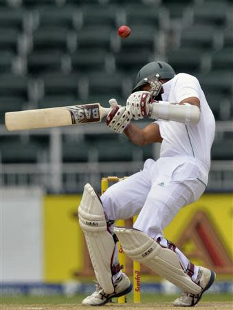 South Africa's Amla ducks under a bounce ball during the second day of their cricket test match against India in Johannesburg