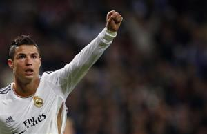 Real Madrid's Ronaldo celebrates his second goal against Sevilla during their Spanish first division soccer match in Madrid