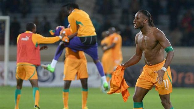 Ivory Coast's Didier Drogba celebrates qualifying for the 2014 FIFA World Cup in Brazil after winning the second leg qualifying football match between Senegal and Ivory Coast on November 16, 2013 (Getty Images)