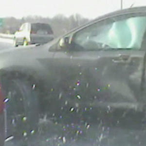 Raw: Out of Control SUV Hits Police Car in Snow
