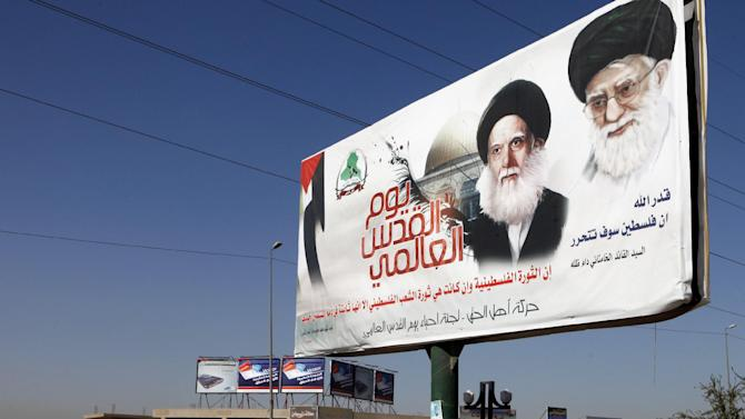 In this photo Sept. 16, 2012, photo, a poster depicting Iran's supreme leader Ayatollah Khamenei, right, and Ayatollah Mohammed Sadiq al-Sadr, late father of the radical anti-U.S. cleric Muqtada al Sadr in Baghdad, Iraq. After years of growing influence, a new sign of Iran's presence in Iraq has hit the streets. Thousands of signs, that is, depicting Iran's supreme leader gently smiling to a population once mobilized against the Islamic Republic in eight years of war. (AP Photo/Karim Kadim)
