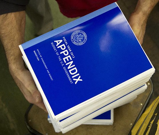 Copies of the a appendix of President Barack Obama's fiscal 2013 federal budget are readied at the Government Printing Office (GPO) in Washington, Thursday, Feb. 9, 2012. (AP Photo/Manuel Balce Ceneta)
