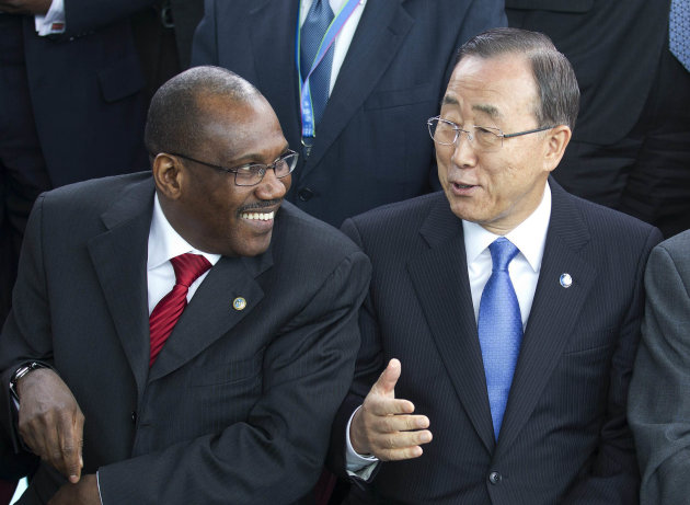 "FILE - In this April 13, 2012, file photo United Nations Secretary-General Ban Ki-moon, center, speaks with Hamadoun Toure, Secretary-General of the International Telecommunication Union (ITU),during a photo session of the UN Chief Executive Board in Geneva, Switzerland. Secret negotiations, preparing for a first-ever summit on international telecommunications, have sparked a wave of rumors, the juiciest of which has the UN seizing control of the Internet from a coalition of nongovernmental organizations that establish web policies, standards and rules. Toure, who will be running the World Conference on International Telecommunications in Dubai this December calls the rumor ""ridiculous."" (AP Photo/Keystone, Salvatore Di Nolfi)"