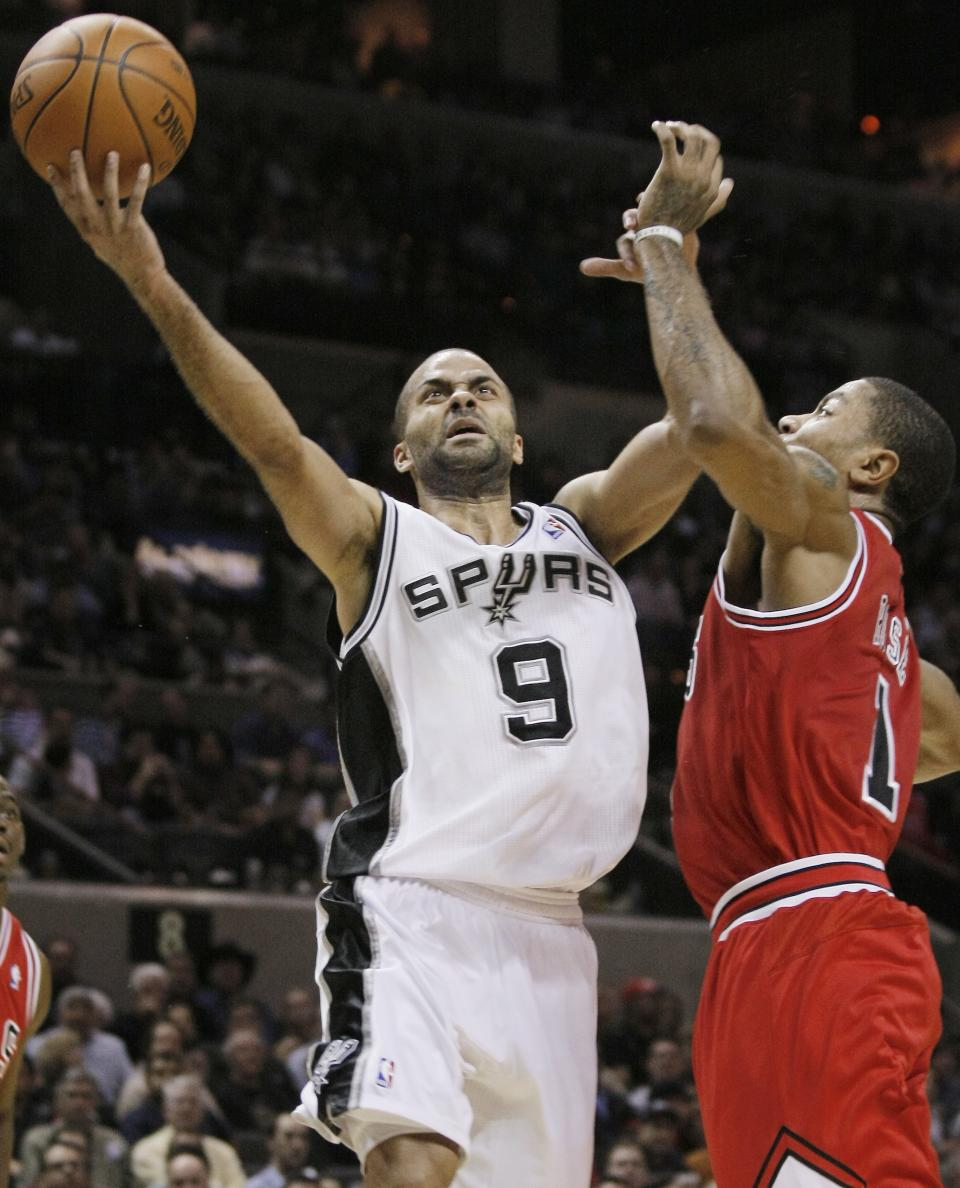 San Antonio Spurs' Tony Parker, left, of France, shoots over Chicago Bulls' Derrick Rose during the first half of an NBA basketball game on Wednesday, Feb. 29, 2012, in San Antonio. (AP Photo/Darren Abate)