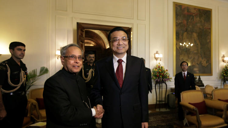 Chinese Premier Li Keqiang, right, poses with Indian President Pranab Mukherjee before a meeting at the Indian Presidential Palace in New Delhi, India, Tuesday, May 21, 2013. Keqiang is on a three-day visit to discuss bilateral and trade ties. (AP Photo /Manish Swarup)