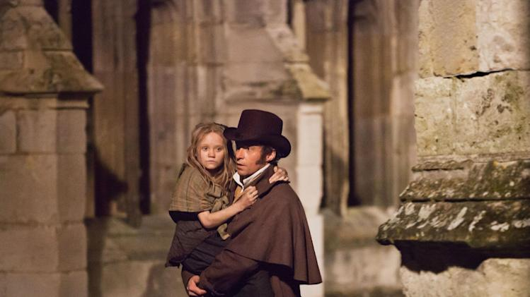 "FILE - This undated publicity image provided by Universal Pictures shows Isabelle Allen, left, as a young Cosette and Hugh Jackman as Jean Valjean in a scene from the motion-picture adaptation of ""Les Misérables,"" directed by Tom Hooper. (AP Photo/Universal Pictures, Laurie Sparham, File)-"