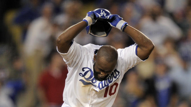 Los Angeles Dodgers' Tony Gwynn throws his helmet to the ground after lining out to first during the ninth inning of their baseball game against the Washington Nationals, Saturday, April 28, 2012, in Los Angeles. (AP Photo/Mark J. Terrill)