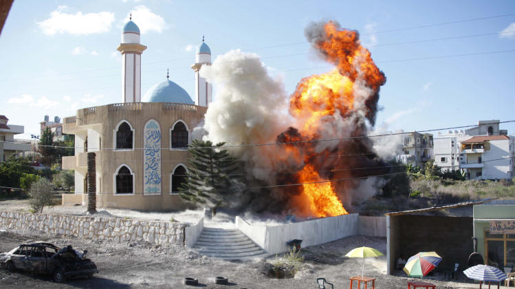 "In this picture taken October 5, 2010, an explosion is seen hitting a mosque on a film set during a scene in the movie 33 Days in Ansariyeh village, southern Lebanon. The film, 33 Days, tells the story of the 2006 war between Israel and the Lebanese militant group Hezbollah in one front-line village and glorifies ""the resistance."" (AP Photo/Mohammed Zaatari)"