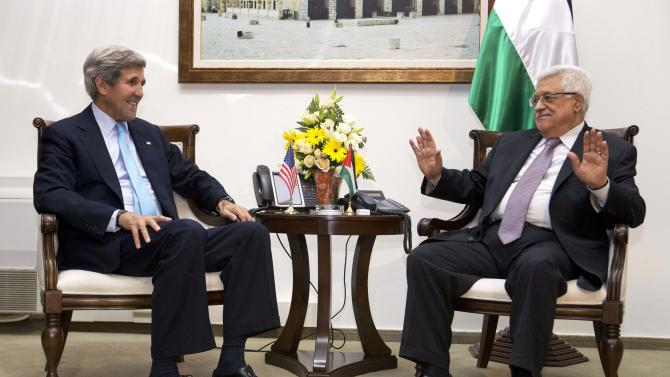 U.S. Secretary of State John Kerry, left, meets with Palestinian President Mahmoud Abbas inside Muqataa, the Palestinian Presidential compound in the West Bank town of Ramallah, on Sunday, June 30, 2013. Kerry, engaged in breakneck shuttle diplomacy to coax Israel and the Palestinians back into peace talks, drove to the West Bank on Sunday to have a third meeting in as many days with Abbas. (AP Photo/Jacquelyn Martin, Pool)