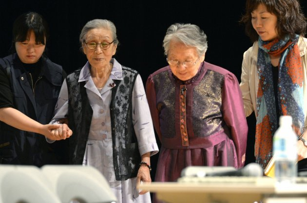 South Korean octogenarians Kim Bok-dong and Kil Won-ok, who were forced to work in Japanese war-time military brothels, attend a meeting in Osaka