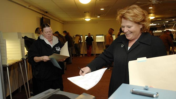 CORRECTS LOCATION TO MANDAN, NOT BISMARCK - Democratic candidate for the North Dakota's U.S. Senate seat, Heidi Heitkamp, casts her ballot in Mandan, N.D., on Tuesday Nov. 6, 2012, in the Kingpin Lounge of a bowling alley in Mandan, N.D. (AP Photo/Will Kincaid)