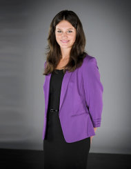 Alice Smith was fired this week and has a very bold purple jacket