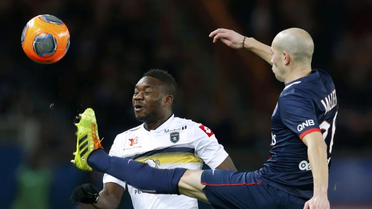 Paris St Germain's Jallet challenges FC Sochaux's Mayuka during their French Ligue 1 soccer match at the Parc des Princes Stadium in Paris