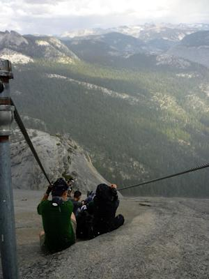 "In this Sept. 24, 2011 photo provided by Armando Castillo, hikers descend Half Dome in Yosemite, National Park. Armando Castillo knew he should not attempt the last treacherous stretch up Half Dome with storm clouds looming. But he felt he had come too far not to accomplish his goal. ""About three quarters of the way up it started hailing,"" he said. ""There's a bunch of people and everybody just stops. Some women started crying because it was slippery and pretty scary. Then it cleared up.""  While others turned back, Castillo pushed on, making him one of Yosemite National Park's worst nightmares, an increasing number of wilderness neophytes who mistakenly think the government is obligated to save them. (AP Photo/Armando Castillo)"