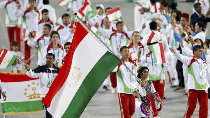 Flag bearer of Tajikistan Chorieva Mavzuna leads the team into the Opening Ceremony of the 17th Asian Games in Incheon