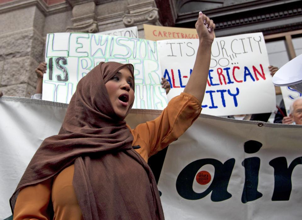 Community advocate Nimo Yonis leads a protest chant against the mayor of Lewiston, Maine, Thursday, Oct. 4, 2012. Critics of the mayor delivered petitions asking for his resignation because of comments he made about Somali refugees in his city. (AP Photo/Robert F. Bukaty)