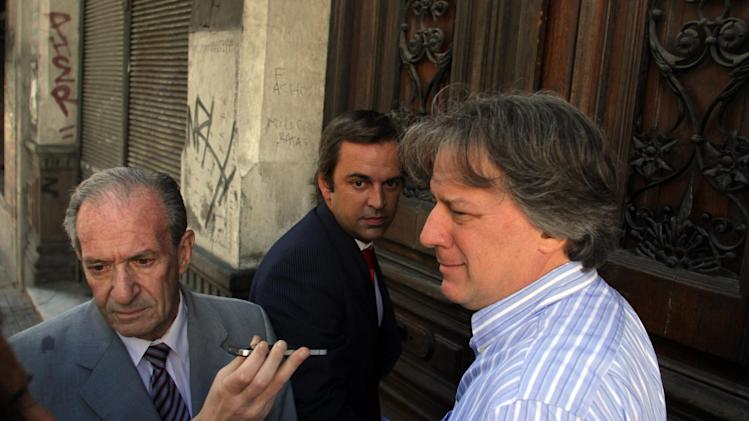 Lorenzo speaks to the media before entering a court in Montevideo