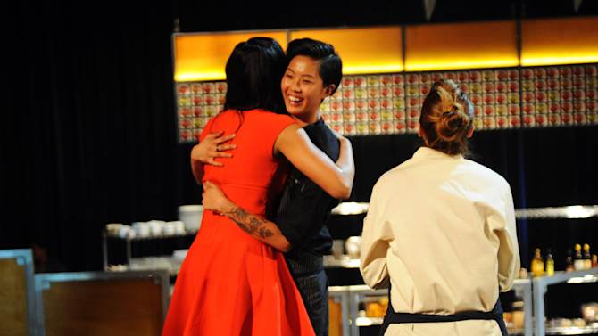 """In this publicity photo released by Bravo, judge Padma Lakshmi, left, embraces """"Top Chef: Seattle"""" winner Kristen Kish, center, while contestant Brooke Williamson looks on during the show's finale that aired Wednesdays, Feb. 27, 2013. The 28-year-old chef de cuisine at Boston restaurant Stir was crowned champion of the Bravo cooking competition Wednesday after facing off against Williamson, the 34-year-old co-executive chef of Los Angeles restaurants Hudson House and The Tripel. (AP Photo/Bravo, David Moir)"""