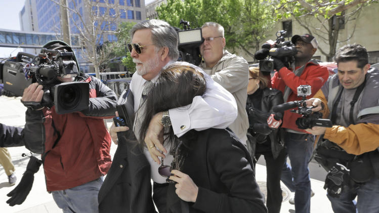 Casey Anthony is protected from the media by her attorney Cheney Mason as she arrives at the United States Courthouse for a bankruptcy hearing Monday, March 4, 2013, in Tampa, Fla. Anthony has not been seen in public since being acquitted in 2011 of murdering her two-year-old daughter Caylee. (AP Photo/Chris O'Meara)