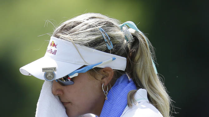 Lexi Thompson wipes sweat from her face before teeing off the 9th hole during the first round of the U.S. Women's Open golf tournament, Thursday, July 5, 2012, in Kohler, Wis. (AP Photo/Julie Jacobson)