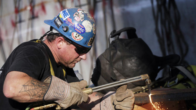 In this Aug. 2, 2012 photo, ironworker Stephen MacGray cuts a steel brace at the World Trade Center construction site, in New York. U.S. employers added 163,000 jobs in July, a hopeful sign after three months of sluggish hiring. The Labor Department said Friday, Aug. 3, 2012, that the unemployment rate rose to 8.3 percent from 8.2 percent in June. July's hiring was the best since February. Still, the economy has added an average of 151,000 jobs a month this year, roughly the same as last year's pace. That's not enough to satisfy the 12.8 million Americans who are unemployed. (AP Photo/Mark Lennihan)