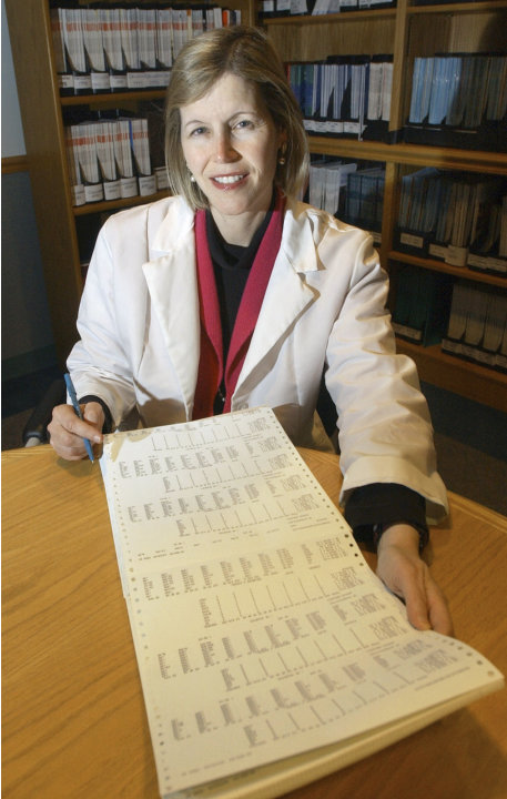 FILE - In this Dec. 12, 2002 file photo, Dr. JoAnn Manson poses for a photo in Boston. Manson, chief of preventive medicine at Harvard's Brigham and Women's Hospital, says women employees are less lik