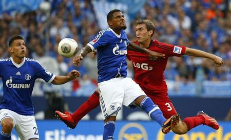Boateng of Schalke 04 challenges Reinartz of Bayer Leverkusen during their German first division Bundesliga soccer match in Gelsenkirchen